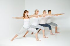 Group of people relaxing and doing yoga in white Stock Photo