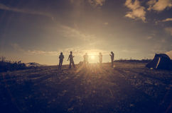Group Of People relaxing on field with Sunset Concept Royalty Free Stock Images