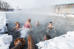 Group of people relaxing in geothermal spa in hot spring pool Royalty Free Stock Photo