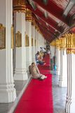 Group of people resting at Wat Phra Kaew, Temple of the Emerald Buddha royalty free stock images