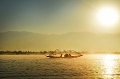 Group of People Riding Boat in the Middle of Water during Sunrise Stock Images