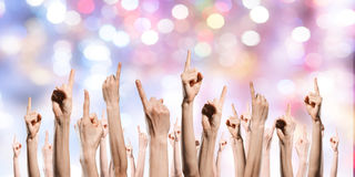 Group of people rise hands . Mixed media. Row of raised hands showing different gestures royalty free stock images