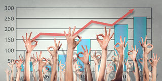 Group of people rise hands . Mixed media Stock Photography