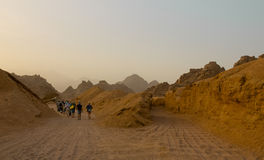 Group of people on the road branching. In the Arabian desert royalty free stock images