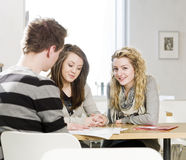 Group of people round a table Stock Images