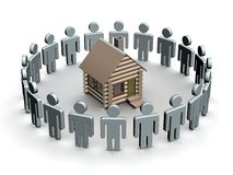 Group of people round a wooden small house. Royalty Free Stock Photo