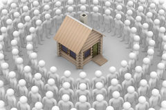 Group of people round a wooden small house Stock Image