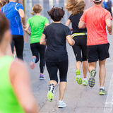 Group of people running. Stock Image
