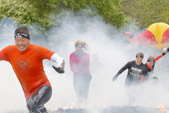Group of people running through fire and smoke Stock Photo