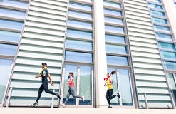 Group of people running in modern urban city area Stock Images
