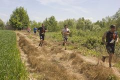 Group of people running outdoor in a field in Tuscany Royalty Free Stock Photography