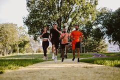 Group of people running in the park royalty free stock images