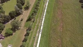 Group of people running by the river from above. Group of people running by the river.. Aerial shot stock video footage