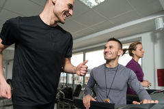 Group Of People Running On Treadmills In Gym Stock Photos