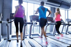 Group of people running on treadmills Royalty Free Stock Photos