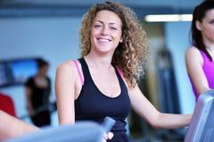 Group of people running on treadmills Stock Photos