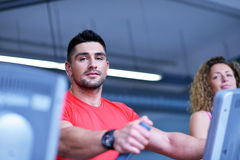 Group of people running on treadmills Stock Image