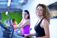 Group of people running on treadmills Royalty Free Stock Photos