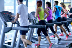 Group of people running on treadmills Stock Photo