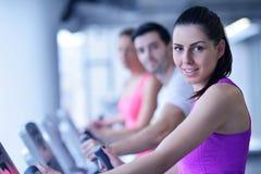 Group of people running on treadmills Stock Photo
