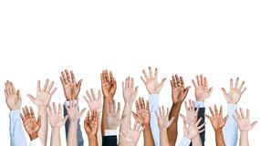 Group Of People's Arms Outstretched In A White background Stock Photos