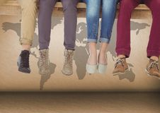 Group of people's legs sitting on wooden plank in front of world map. Digital composite of Group of people's legs sitting on wooden plank in front of world map Stock Photography