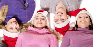 Group people in santa hat lying head next to head. Stock Photo