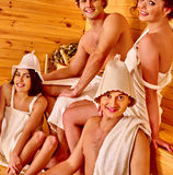 Group people in Santa hat  at sauna Stock Image