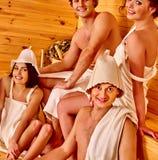 Group people in Santa hat  at sauna Stock Image