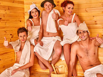 Group people in Santa hat  at sauna Royalty Free Stock Image
