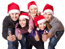 Group  people in santa hat show thumbs up. Stock Photos