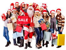 Group people and Santa. Group people and Santa holding gift box near Christmas tree Royalty Free Stock Photos