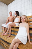 Group of people in sauna. Group of people sitting on bench in a sauna Royalty Free Stock Photo