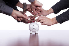 Group of people saving money Stock Photo