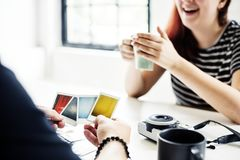 Group of people are selecting photos Royalty Free Stock Images
