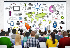 Group of People in Seminar with Symbols Royalty Free Stock Photos