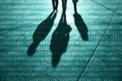 Group of people shadows with binary numbers Stock Images