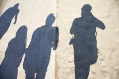 Group people shadows on city street Stock Photos