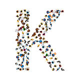 A group of people in the shape of English alphabet letter K on light background. Vector illustration. Royalty Free Stock Photography
