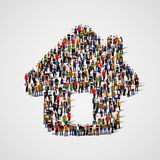 A group of people in a shape of house icon, isolated on white background. Stock Photos