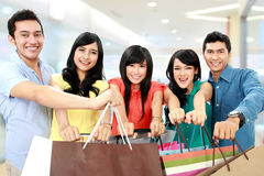 Group of people shopping. Group of people holding many shopping bags shopping together on white background royalty free stock photos