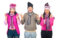 Group of people shouting together. Group of three people standing in a row,wearing woolen clothes and shouting together isolated on white background Royalty Free Stock Photos