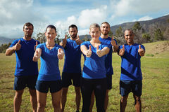 Group of people showing thumbs up during boot camp training Royalty Free Stock Images