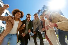 Group of people showing thumbs up in city Stock Photos