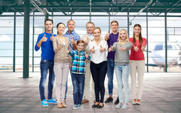 Group of people showing thumbs up over airport Stock Photo