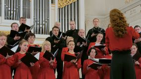Group of people singing in choir stock footage