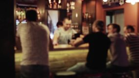 Group of people is sitting in a bar