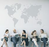 Group of people sitting on chairs royalty free stock photography