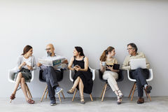 Group of people sitting on chairs stock photography