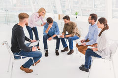 Group of people sitting in circle royalty free stock image